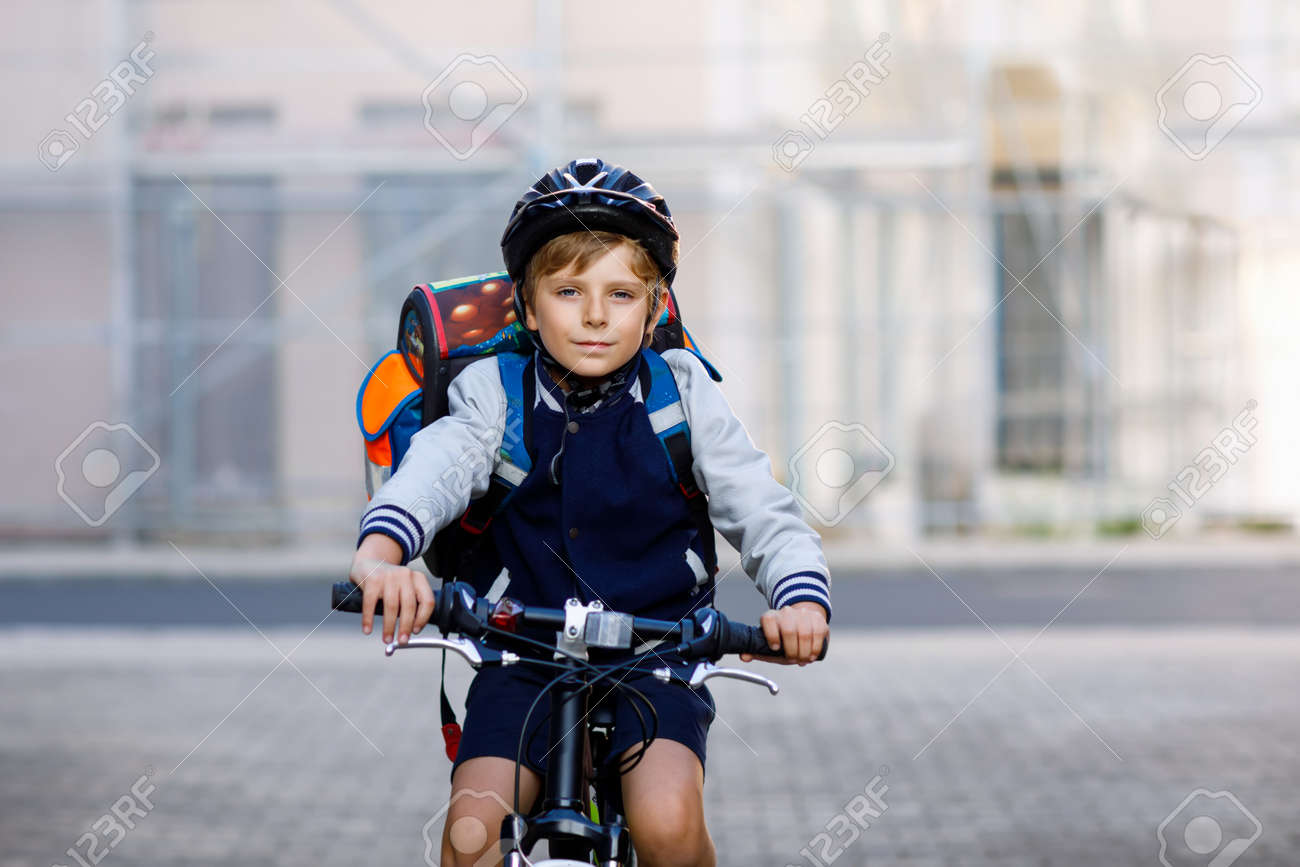 Schoolkid Boy In Safety Helmet Riding With Bike In The City With Stock Photo Picture And Royalty Free Image Image 107449851