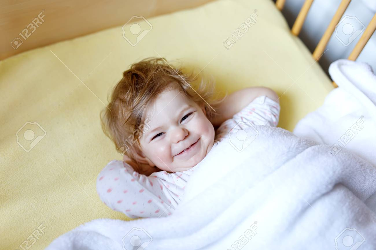 Cute Little Baby Girl Lying In Cot Before Sleeping Happy Calm Stock Photo Picture And Royalty Free Image Image 107449863