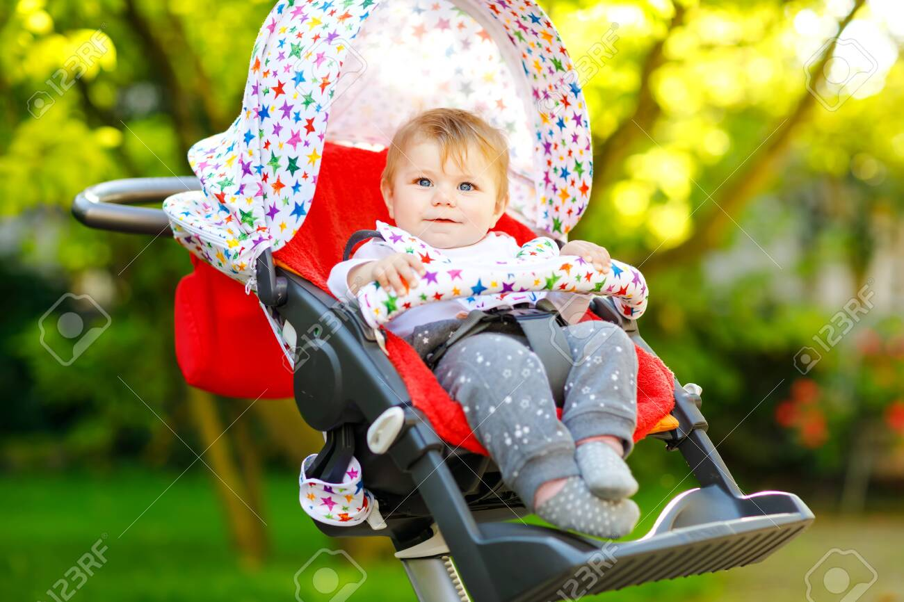 139027898 cute healthy little beautiful baby girl sitting in the pram or stroller and waiting for mom happy sm