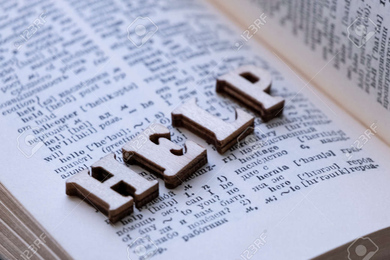 English-Russian dictionary  The word HELP from wooden letters