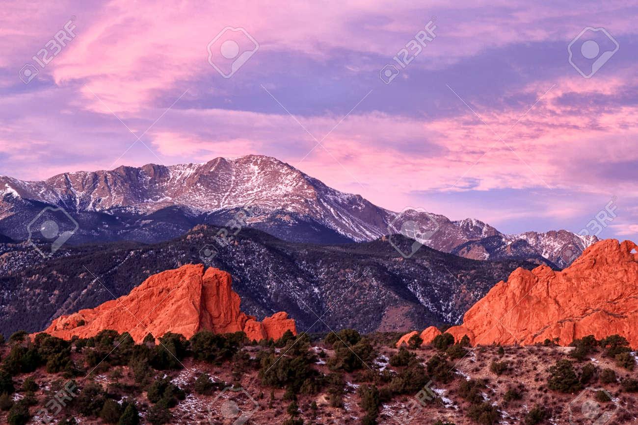A Purple Pikes peak Mountain overlooking Garden of the Gods in..