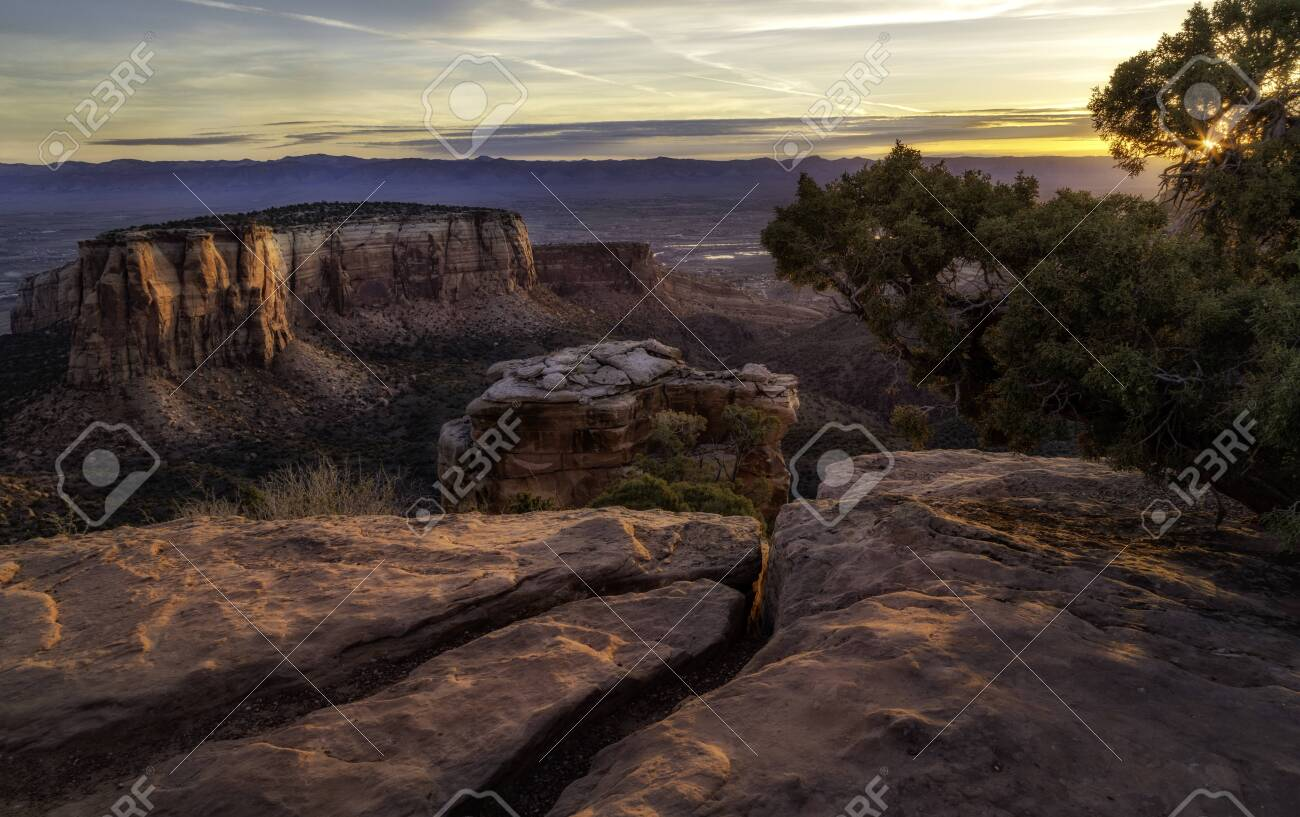 Rock formations flow in the morning sunlight along the overlook at Colorado National Monument located in Grand Junction, Colorado - 127918165