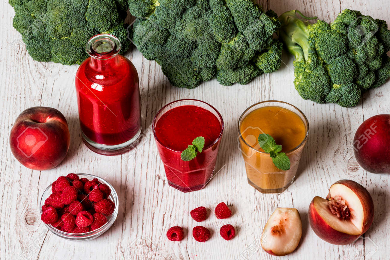 healthy drinks raspberry fresh smoothie in glass and bottle stock