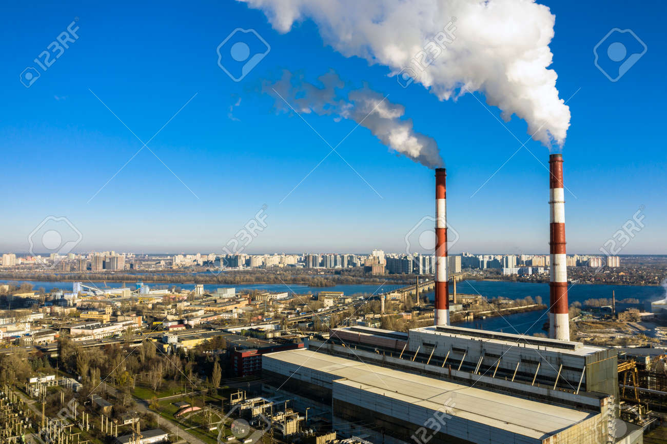 Garbage incineration plant. Waste incinerator plant with smoking smokestack. The problem of environmental pollution by factories aerial view - 167848423