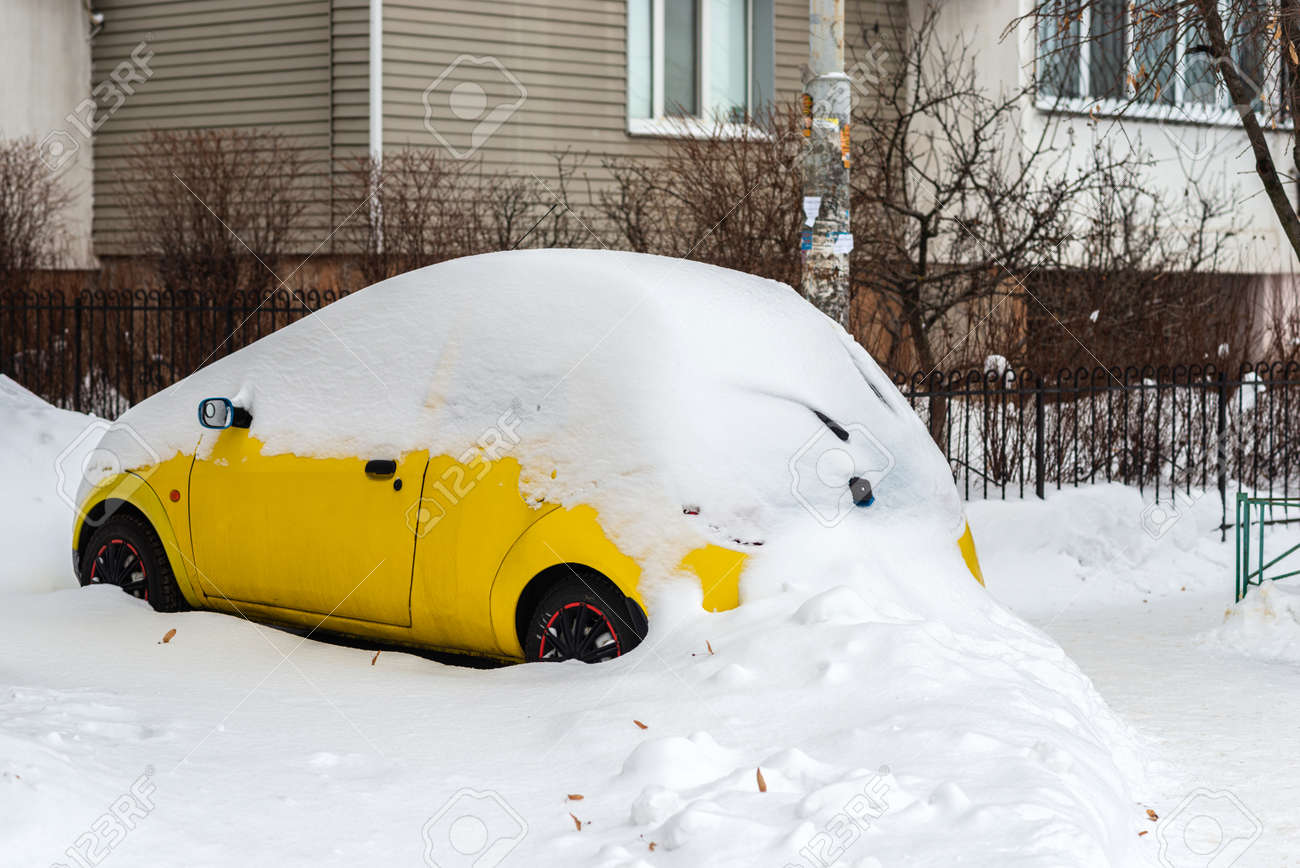 Car covered with snow in urban area - 163754750