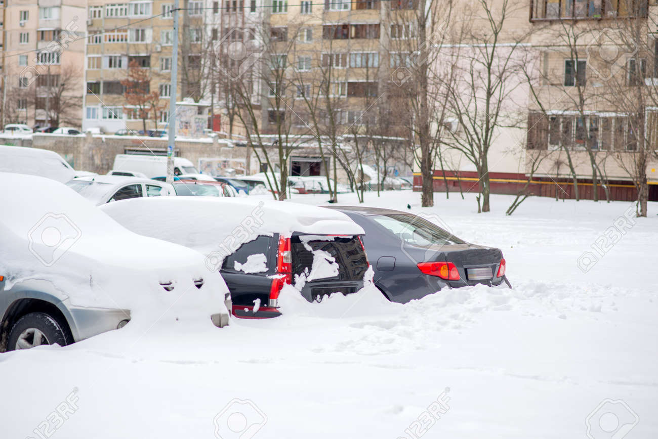 Cars covered with snow in the yard - 163918214