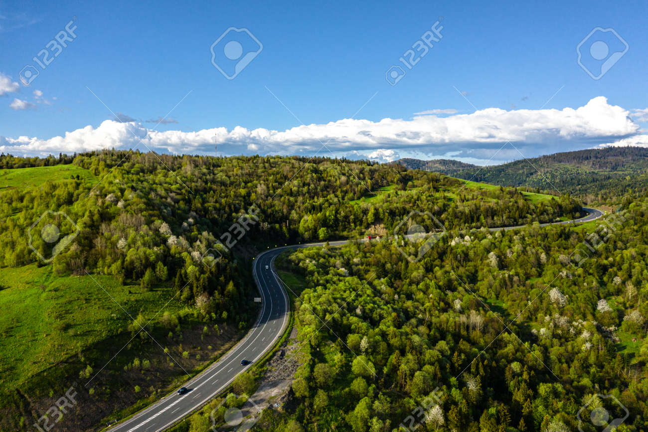 Long Curvy Forest Road In Mountains aerial view - 170818703