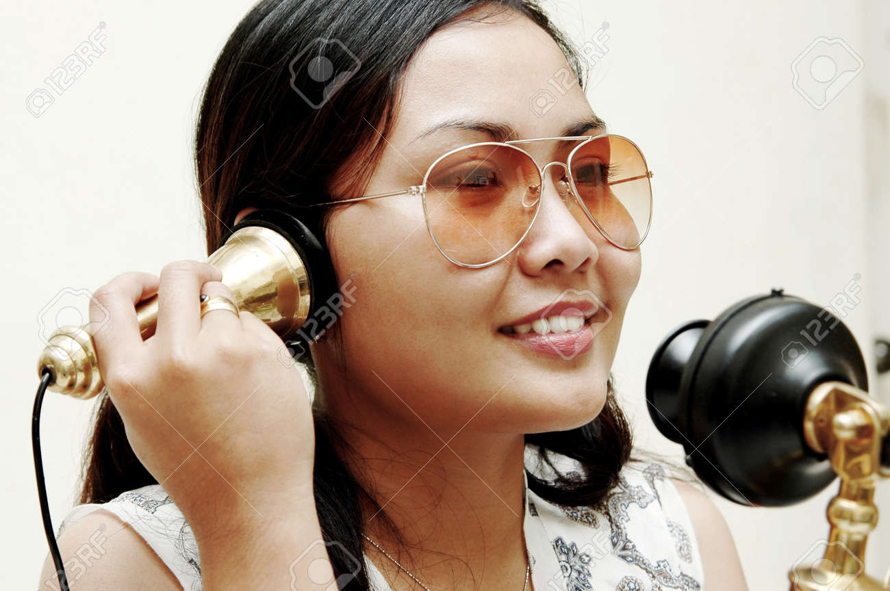 Women talking to the antique phone Stock Photo - 296149