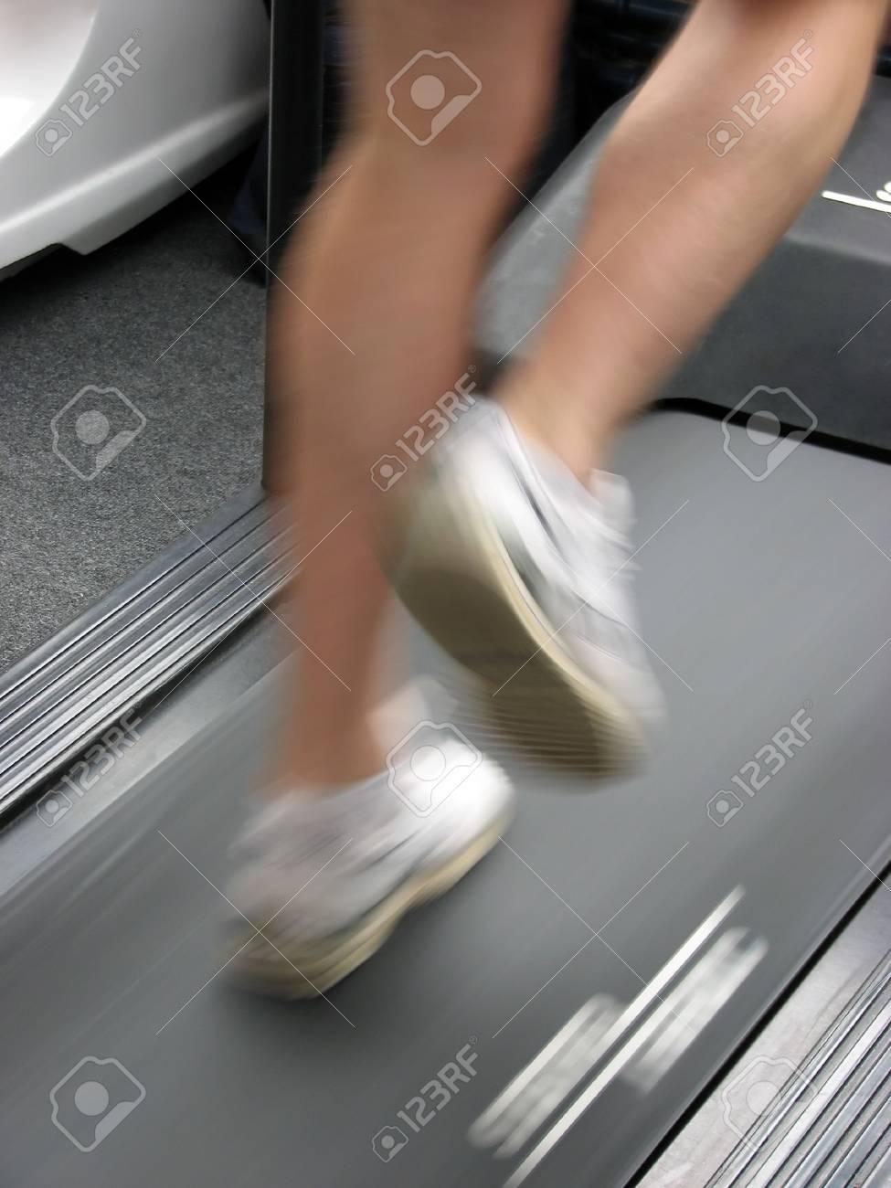 Male running on gymnasium treadmill. Stock Photo - 868483