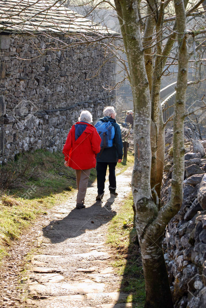 Elderly couple walking in country lane in Grassington, Yorkshire. Stock Photo - 3218490