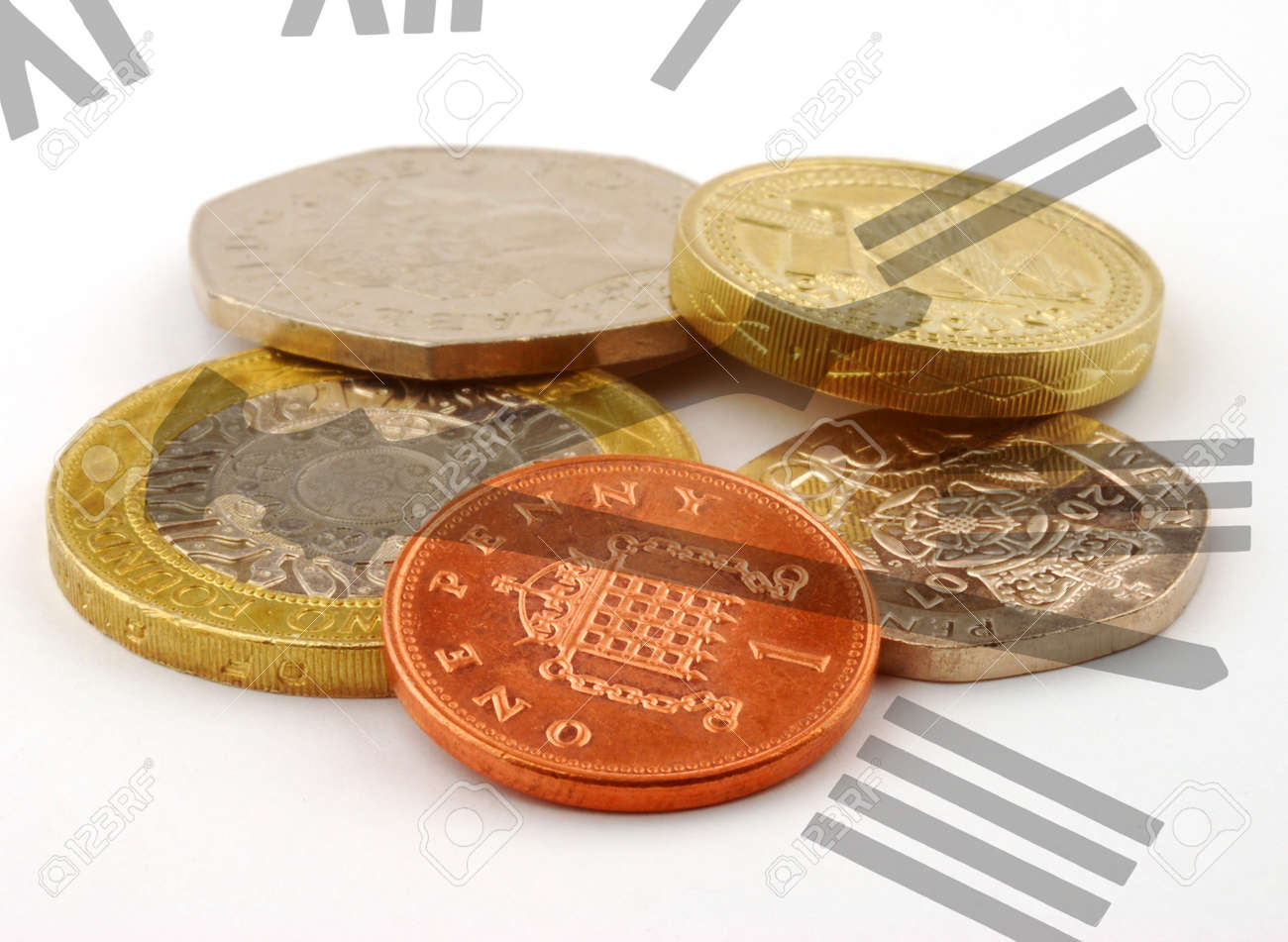 Clock face overlaid over pile of UK coins Stock Photo - 4269921