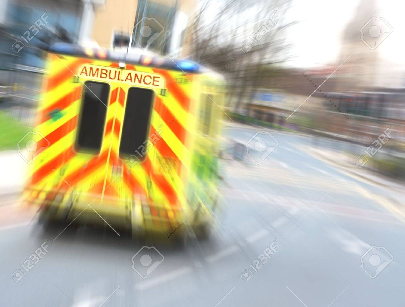 Speeding ambulance flies through city street with zoom blur - 8005235