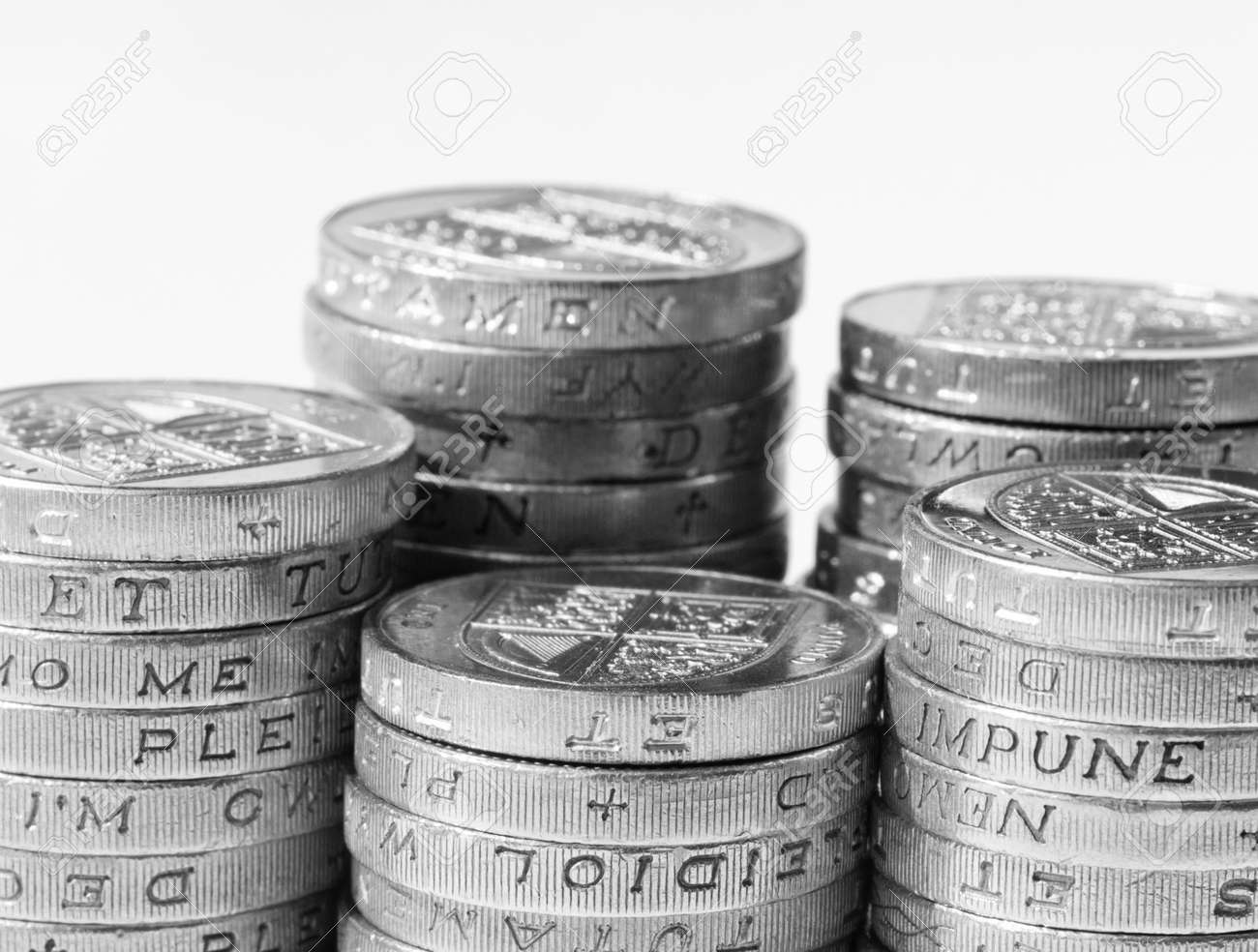 Stack of UK coins on white background Stock Photo - 11928106