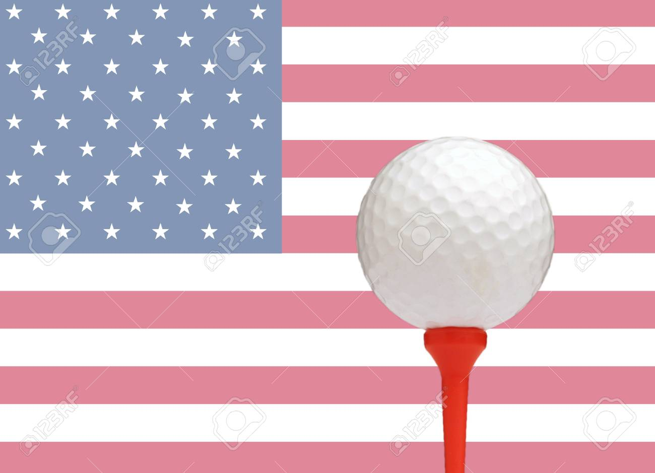 golf ball on tee in front of the flag of the united states of