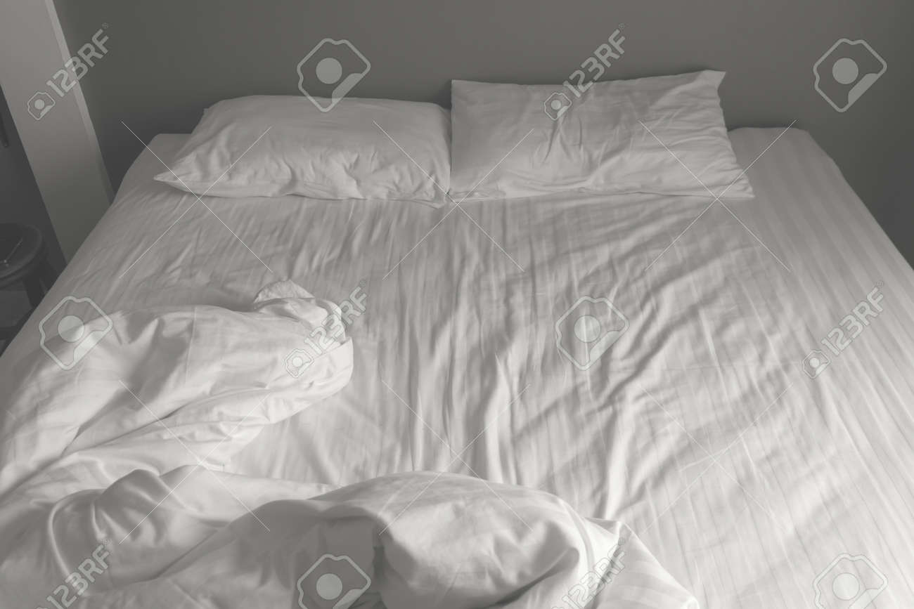 Messy White Bedding Sheets And Pillows. Black And White Tone Stock Photo    82063048