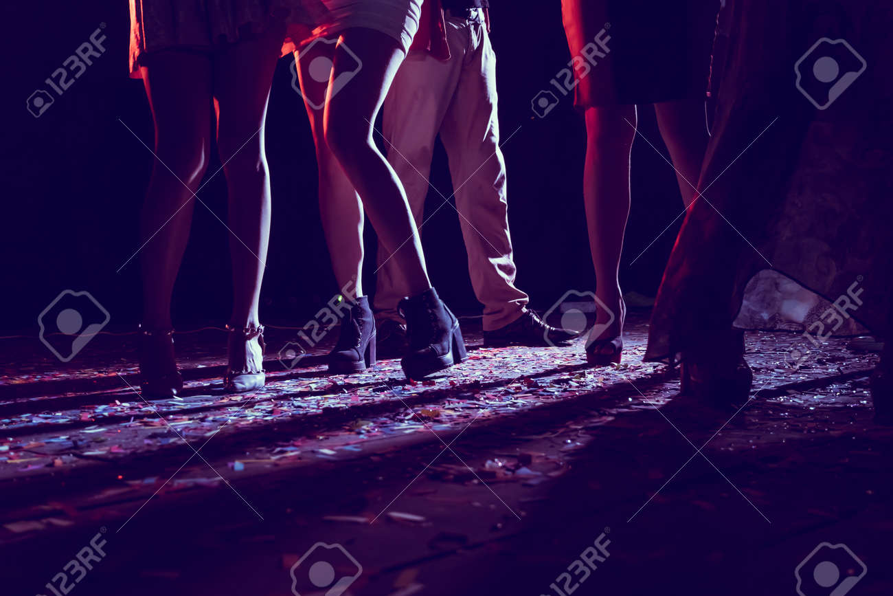 Legs of dancing people at the party. - 89904851