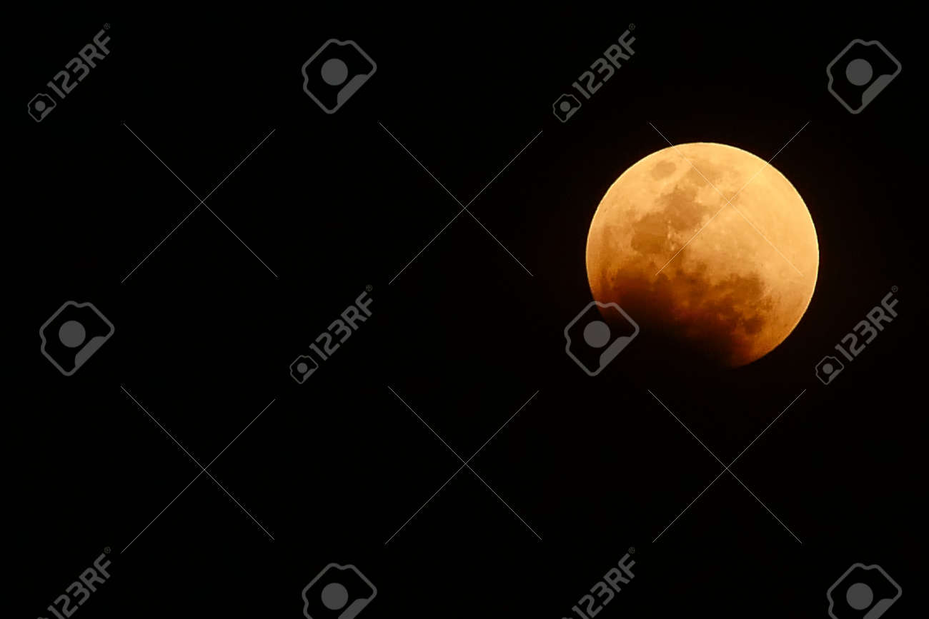 bloody red moon, total Lunar eclipse as seen from Bangkok, Thailand. - 94580162
