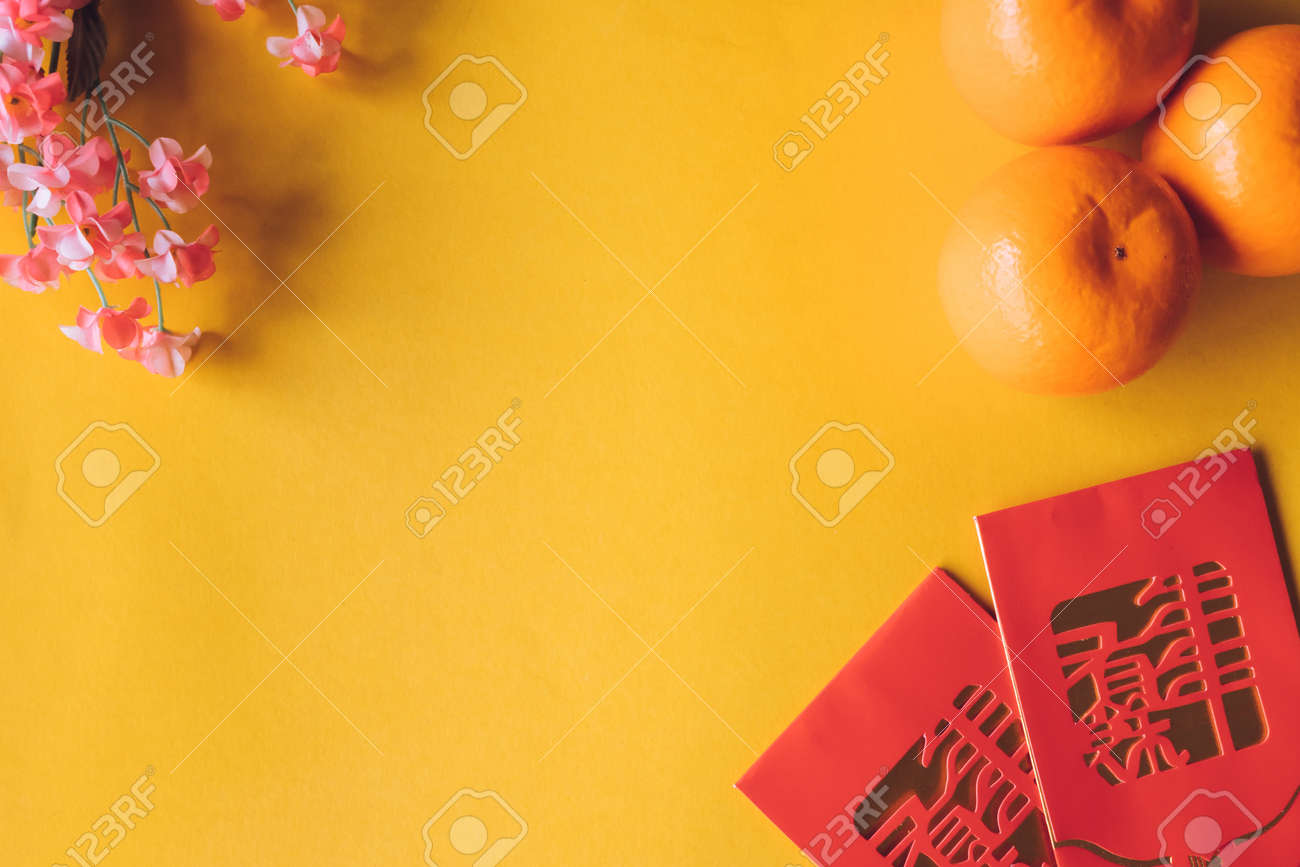 Top view of Chinese new year festival decorations on yellow background. Free space for text - 95713946