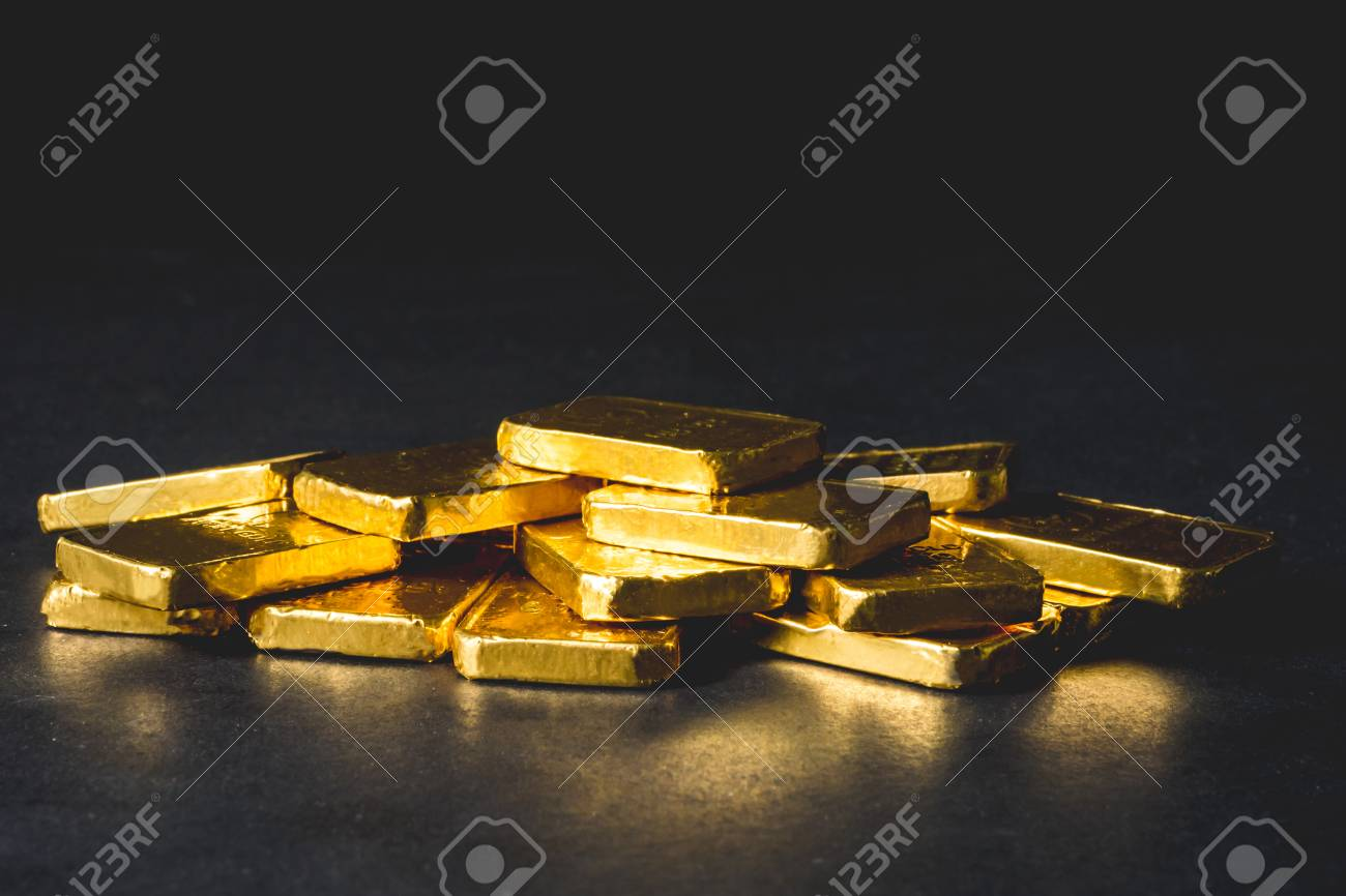 Stack of Pure gold bars on black background - 99660256