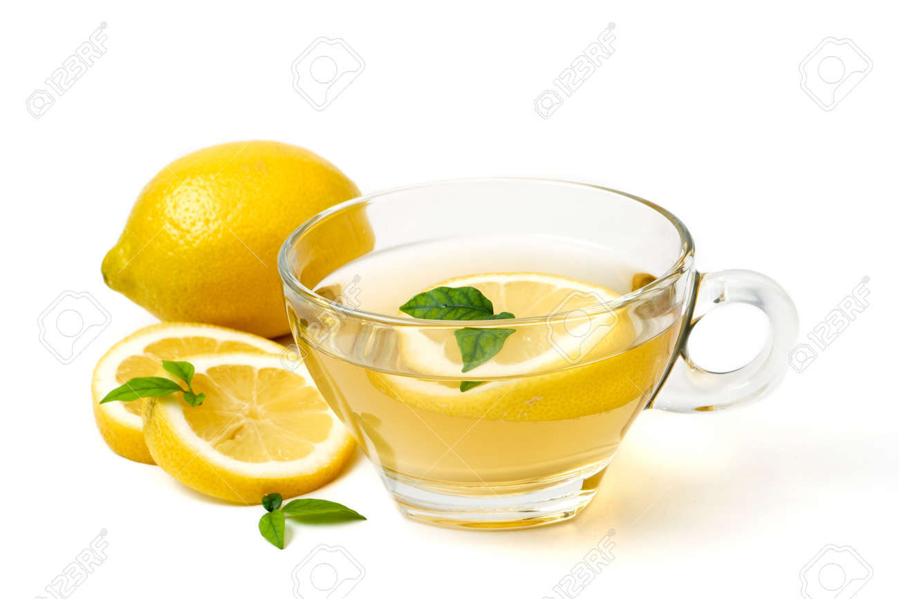 A cup of tea and lemon on a white background - 99664677