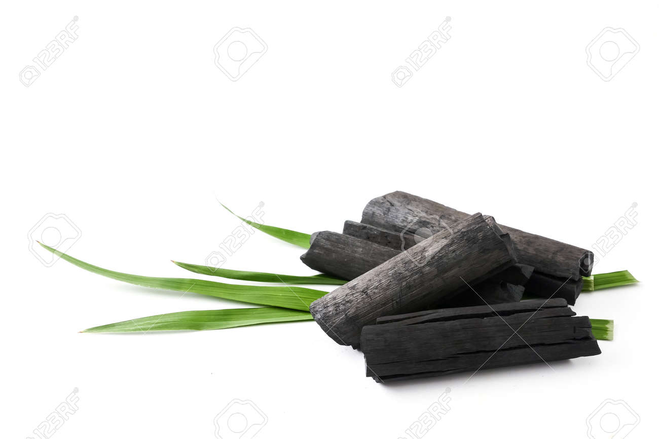 Natural wood charcoal on white background - 105102524