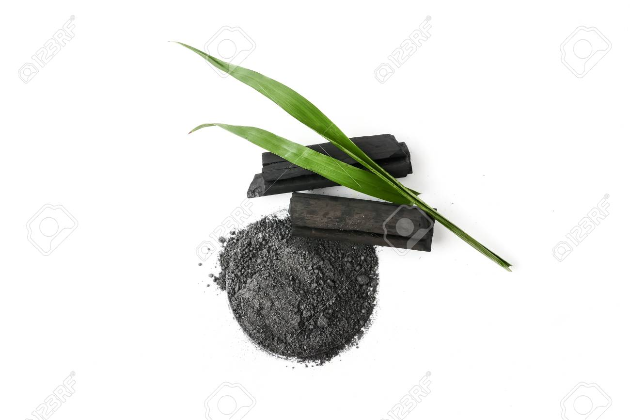 Activated charcoal powder on white background - 105364783
