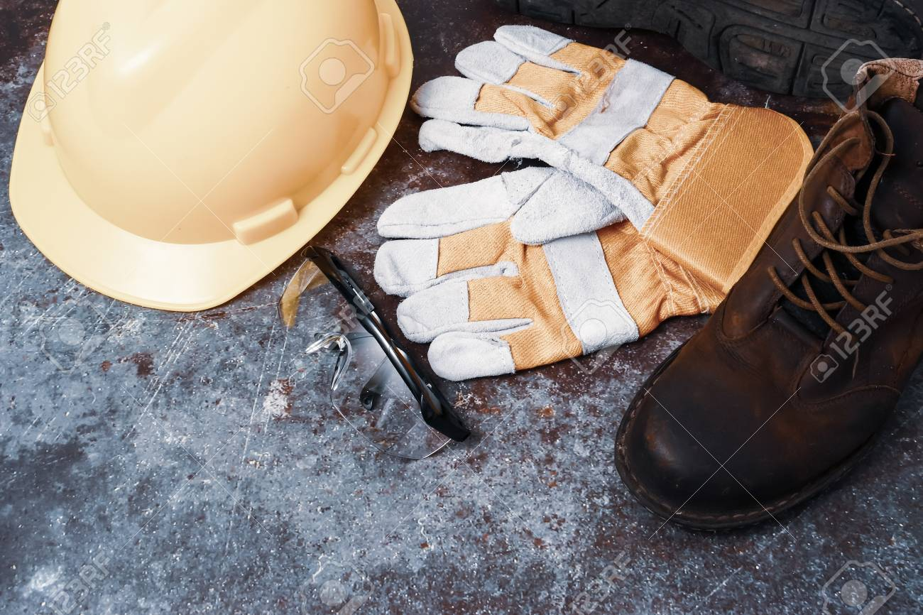 Construction site safety. Personal protective equipment on rusty old metal texture background - 105364785