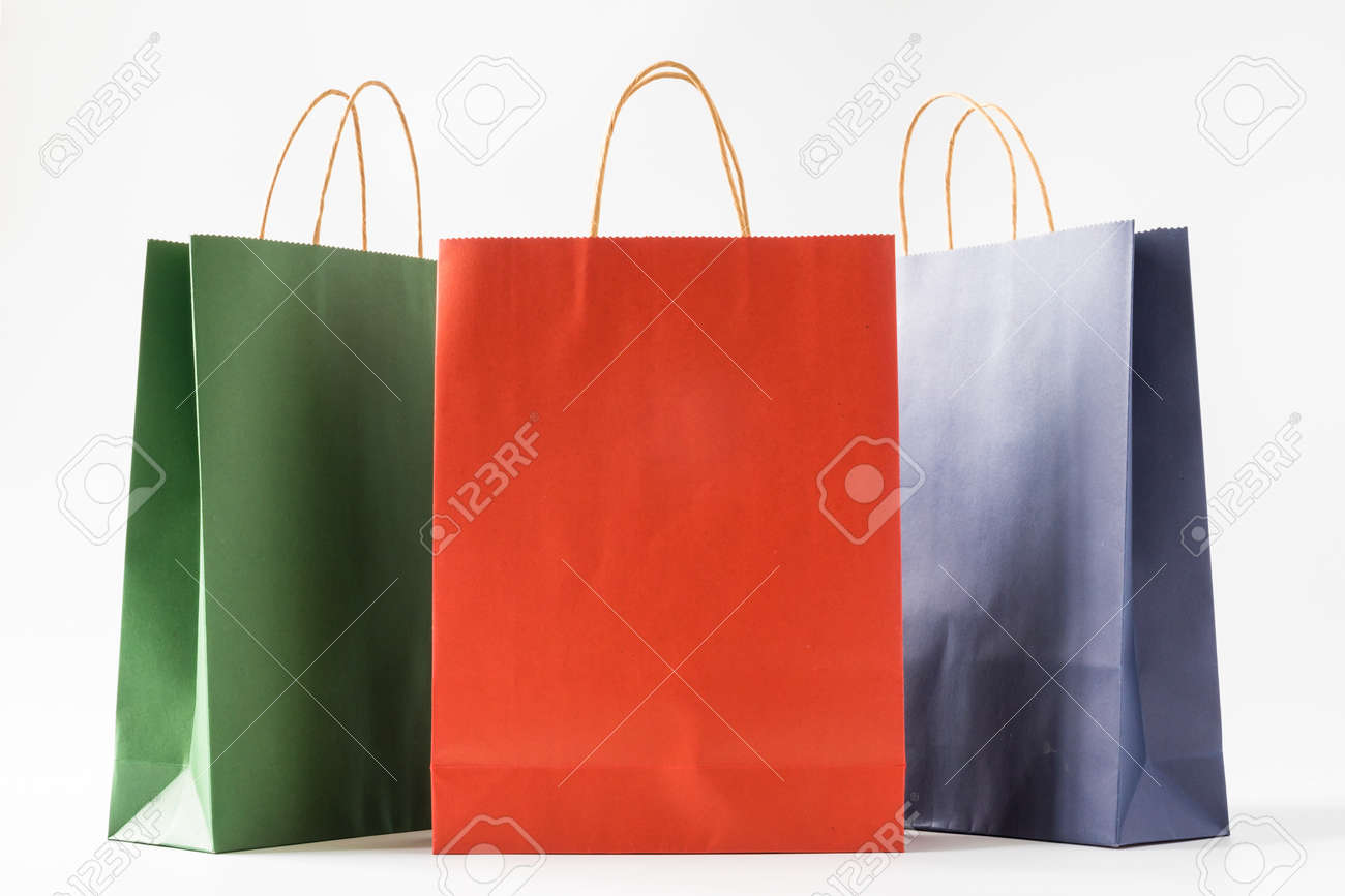 Colourful paper shopping bags on white background - 109206592