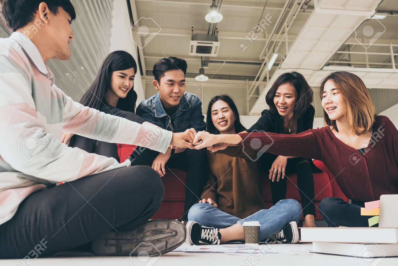 Young successful businesspeople are fist bumping after working hard at new project - 109816546