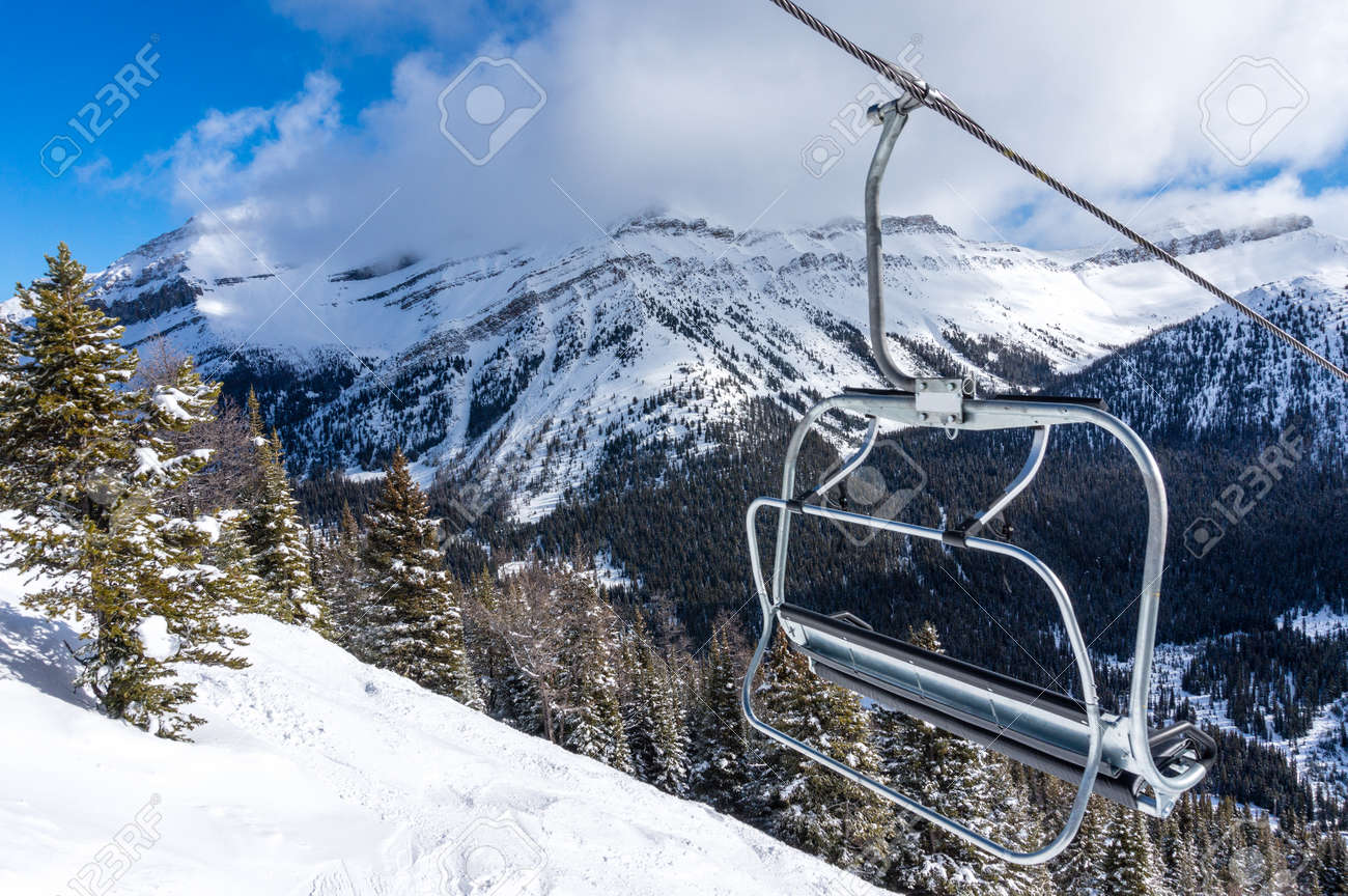 empty chair lift empty ski lift chair with rocky mountains in the background stock photo 36979540 ski lift chair with in the background