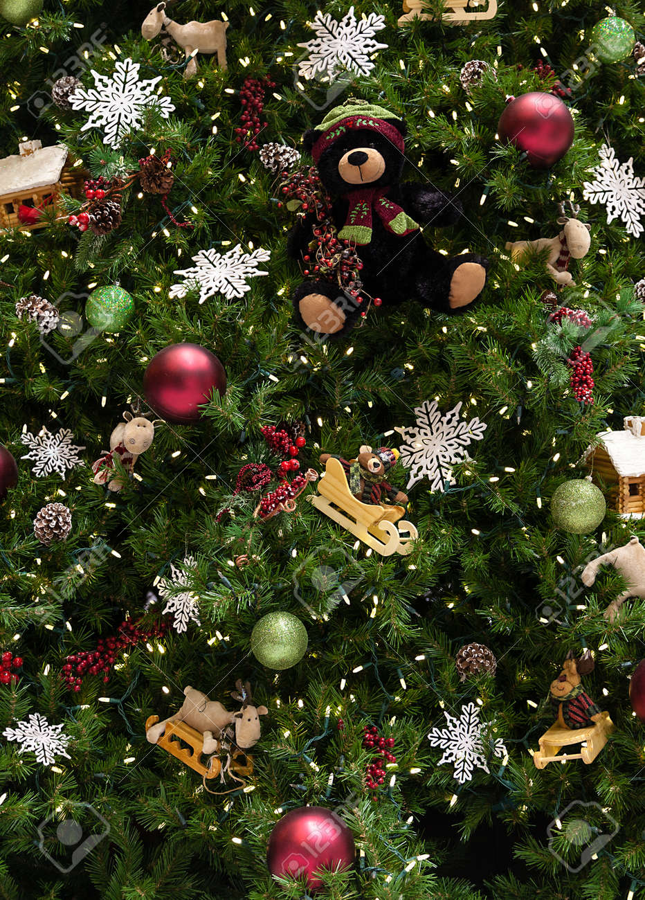 Close Up Of Christmas Tree With Ornaments Of Baubles Snowflakes