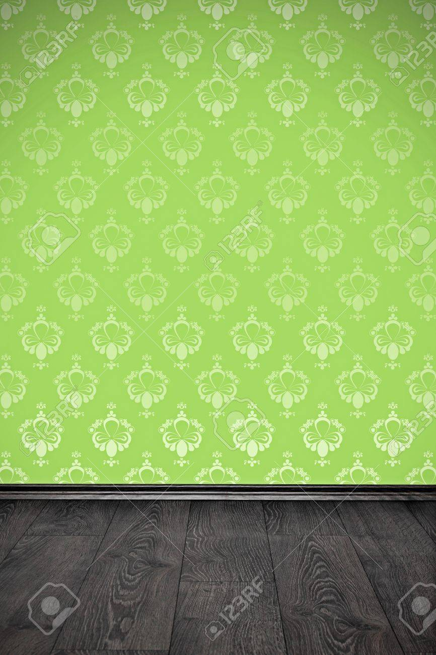 blank wall with green floral wallpaper and wooden floor - 19263495