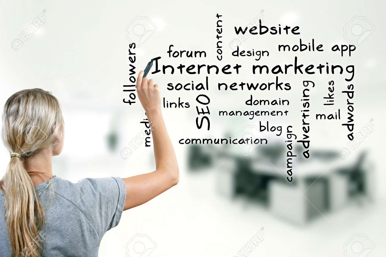 woman writing internet marketing concept keywords Stock Photo - 23870094