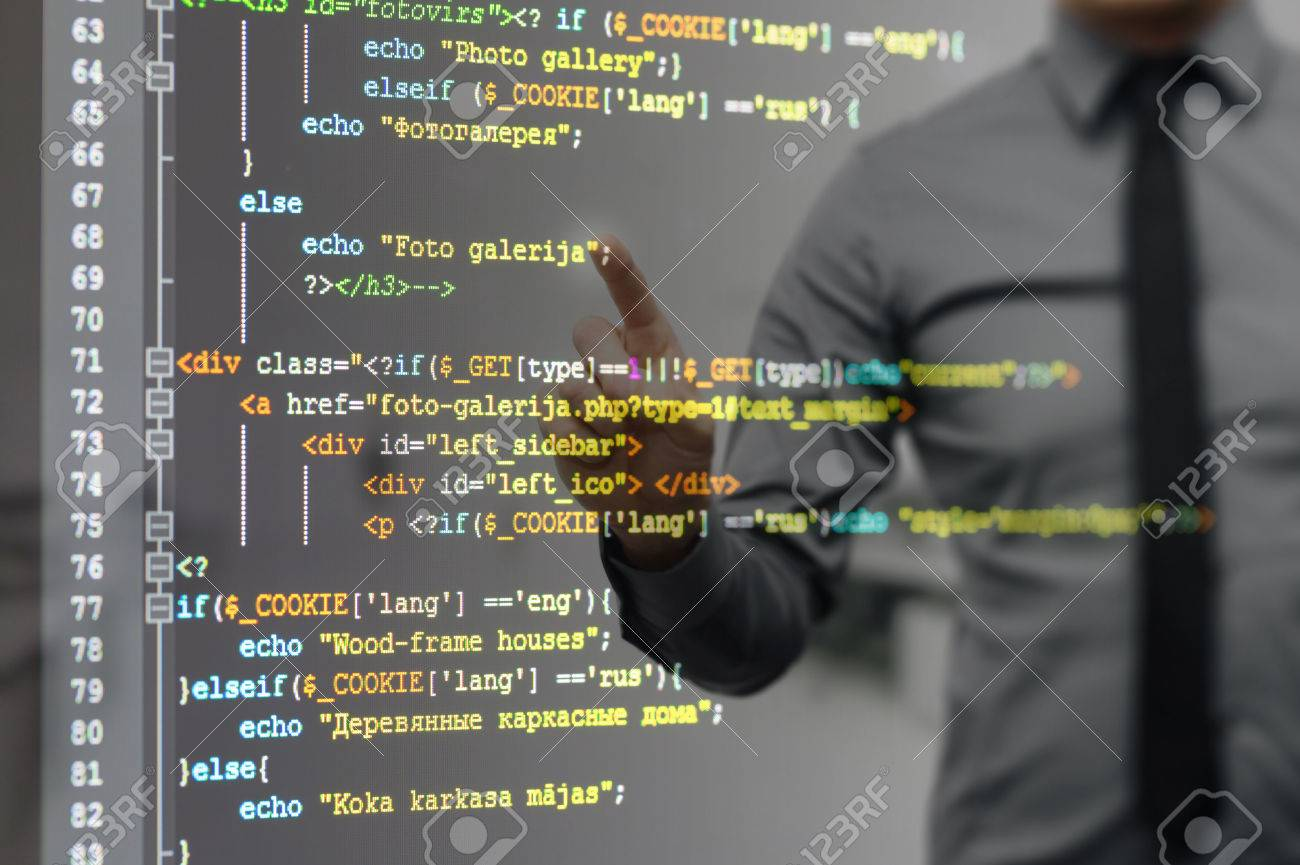 man pointing on virtual screen with website programming code - 53827861