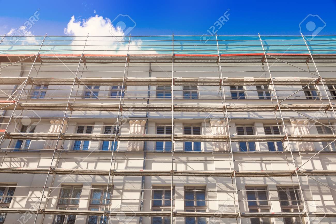 house exterior with scaffold - old town building facade restoration - 57525681