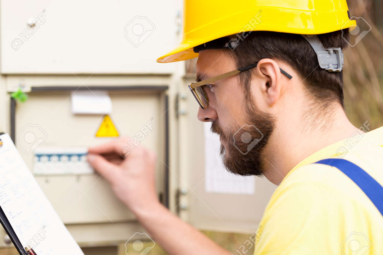 electrician checking fuse box Stock Photo - 57525689