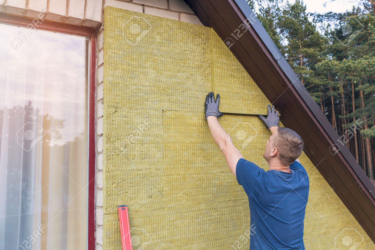 house insulation - insulating house facade with mineral rock wool - 57525735