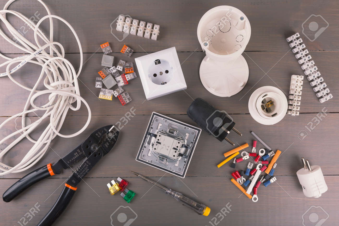 Electrical Tools And Accessories On Wooden Table Stock Photo