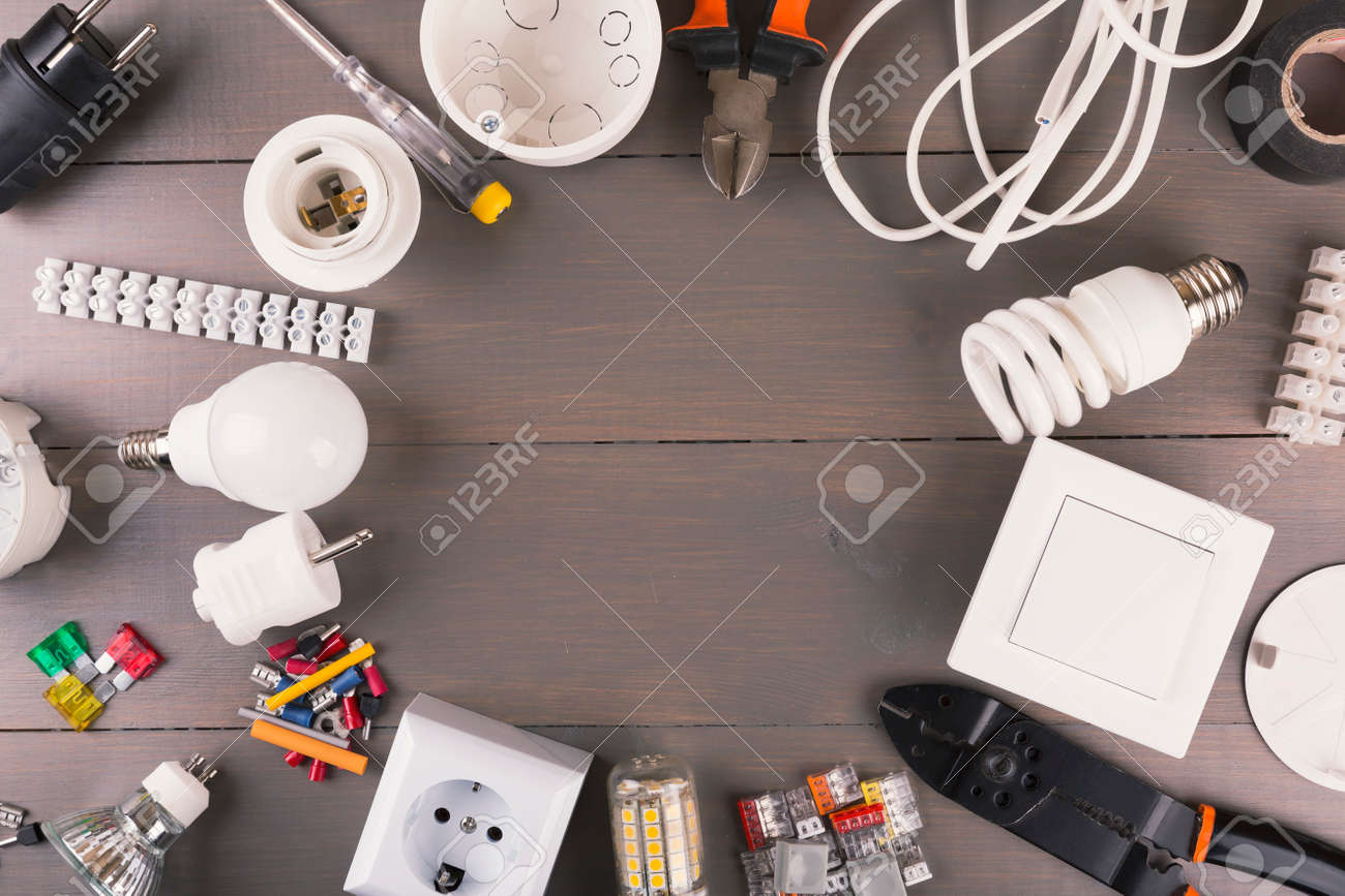 top view of electrical tools and equipment on wooden table - 59194465
