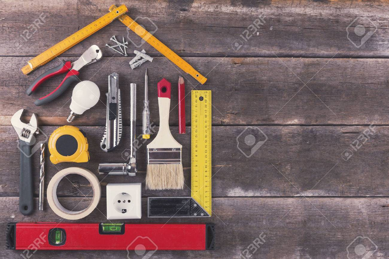 house renovation and improvement DIY tools on old wooden background - 62429743