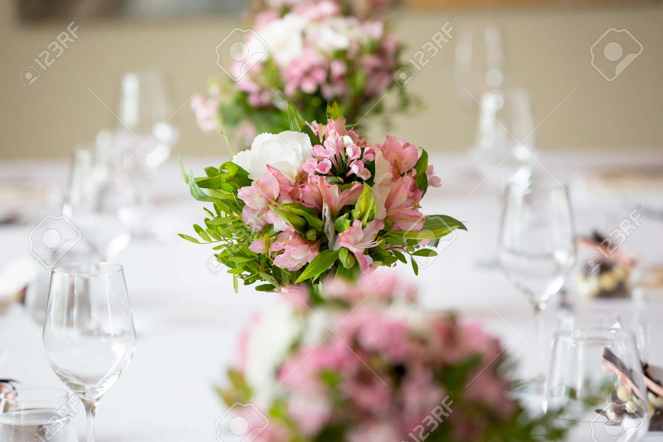wedding banquet table flower decoration in a restaurant - 62429747