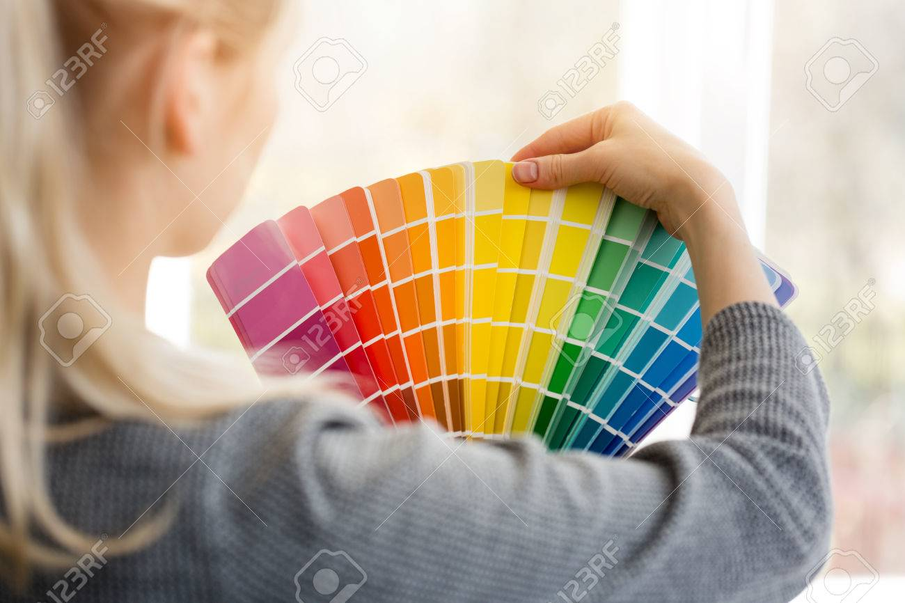 woman designer choosing interior design color from swatch palette