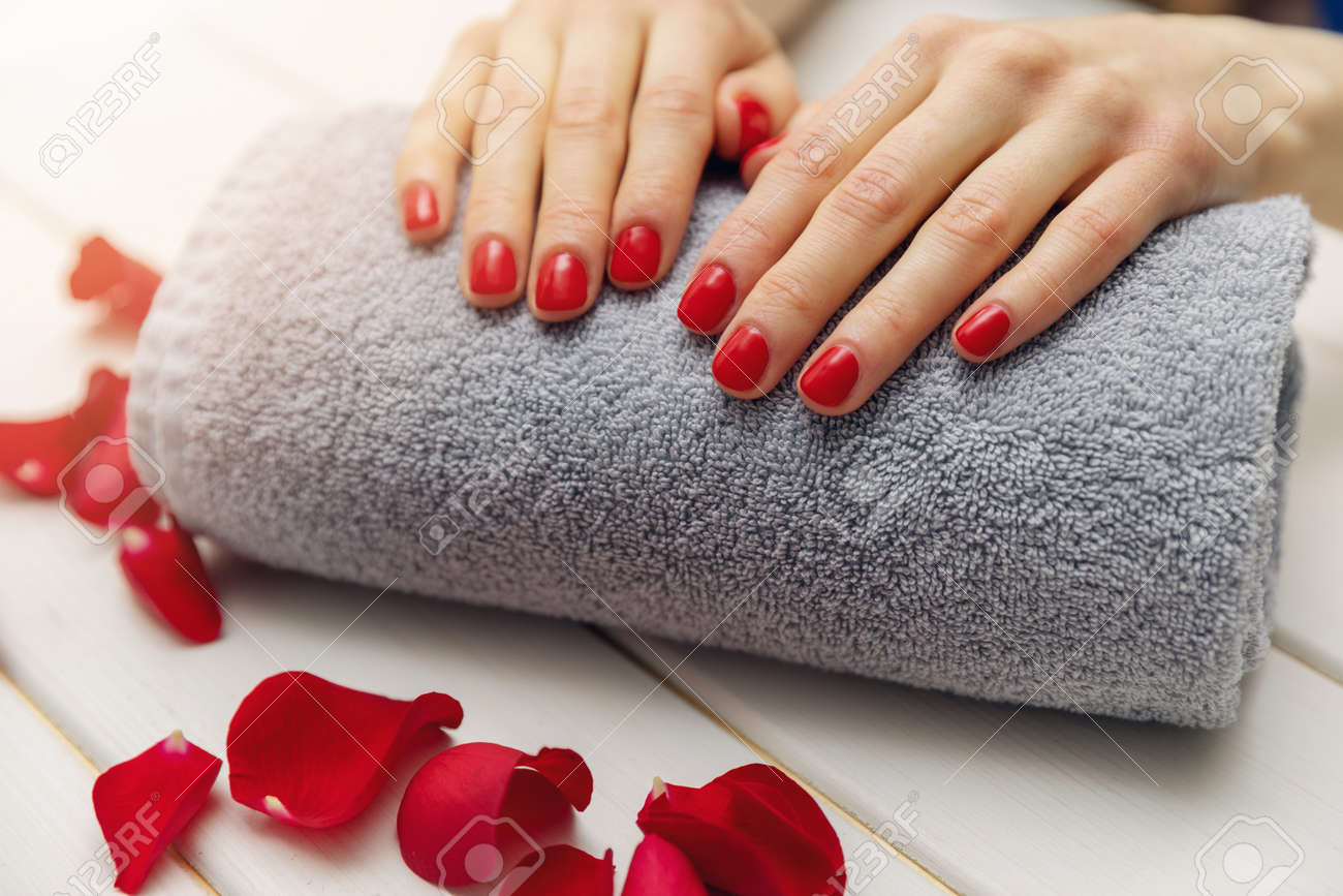 Woman Fingernails With Red Nail Polish On Towel Roll Perfect.. Stock ...