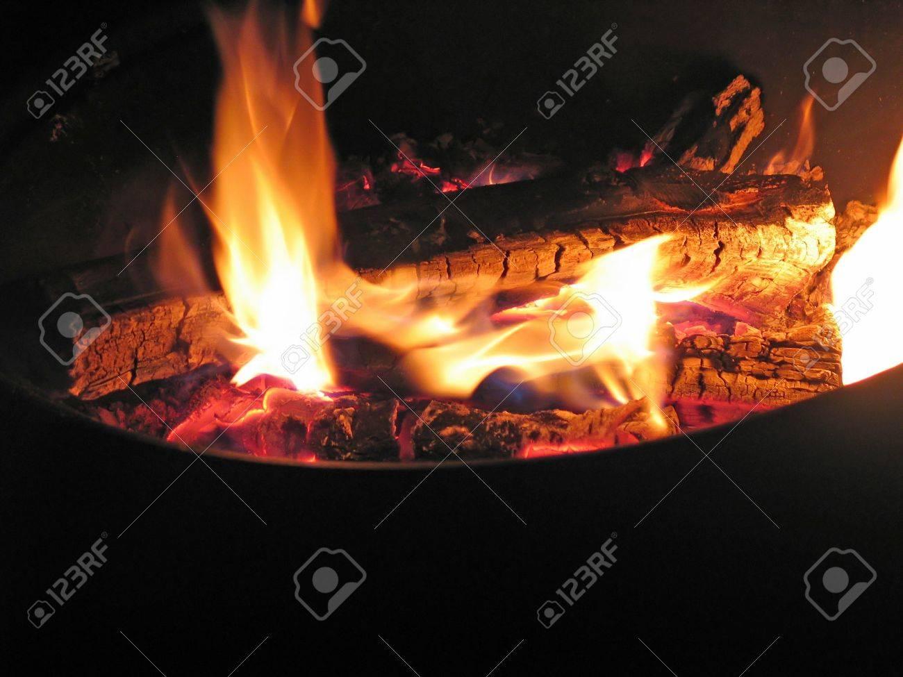 Close up of bonfire pit with blazing flames Stock Photo - 2415459
