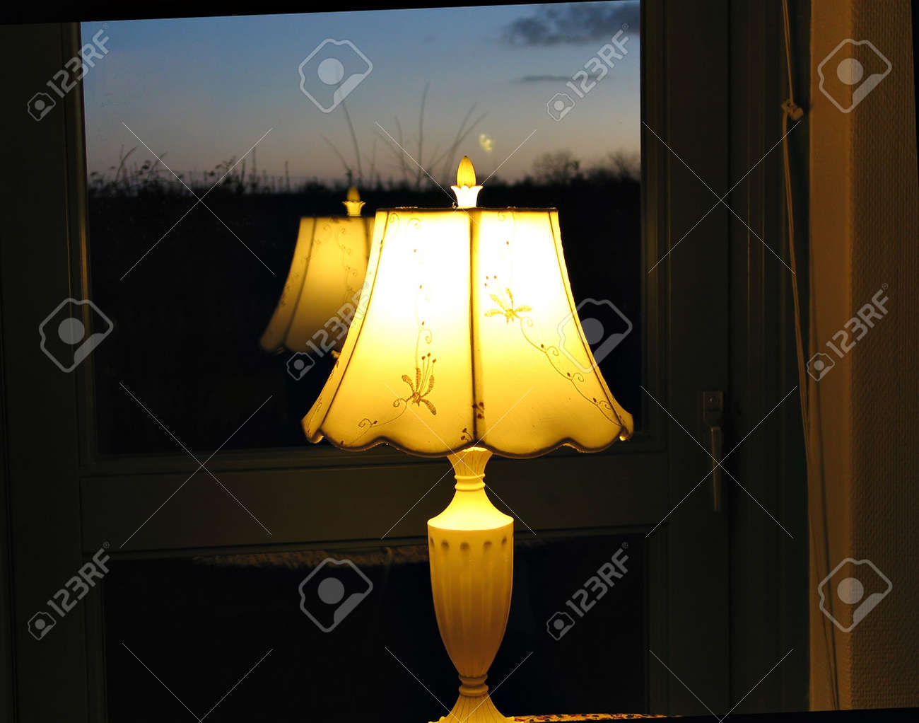 Reflection Of A Decorative Night Lamp On A Window Stock Photo   2602531