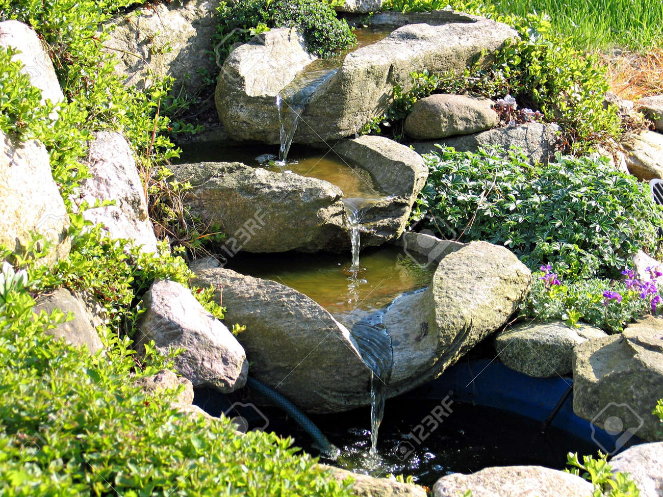 Beautiful decorative home garden stone waterfall pond Stock Photo - 3075028