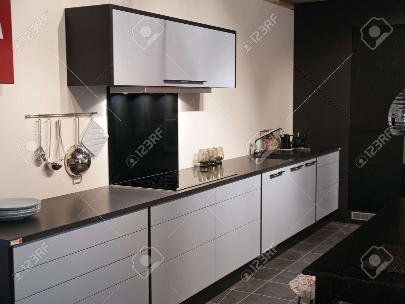 Modern design trendy kitchen with black and white wood elements and metal Stock Photo - 4866924