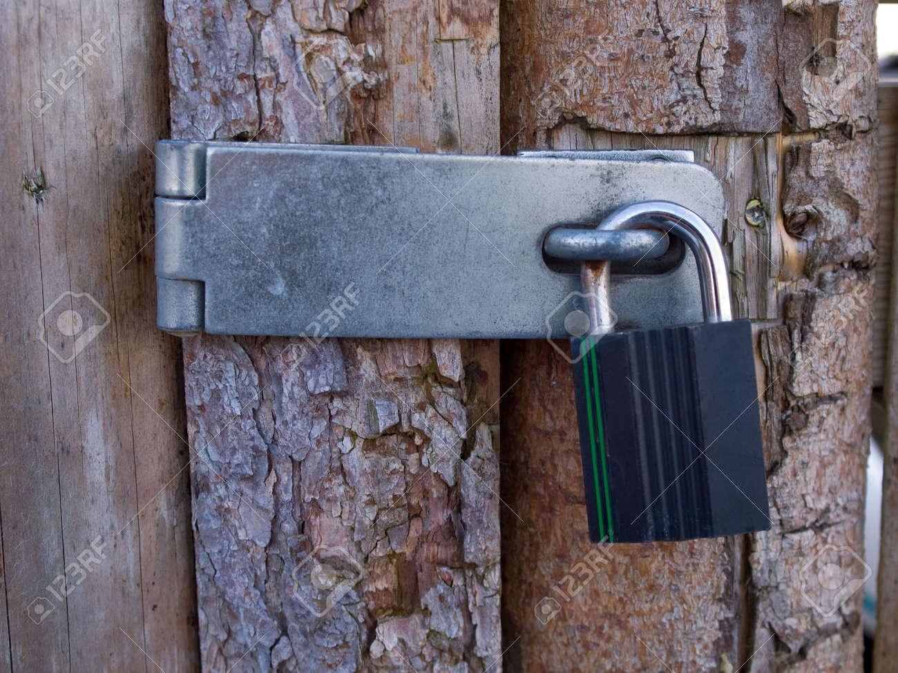 Wooden door locked with a heavy metal lock padlock Stock Photo - 6566043 & Wooden Door Locked With A Heavy Metal Lock Padlock Stock Photo ... Pezcame.Com