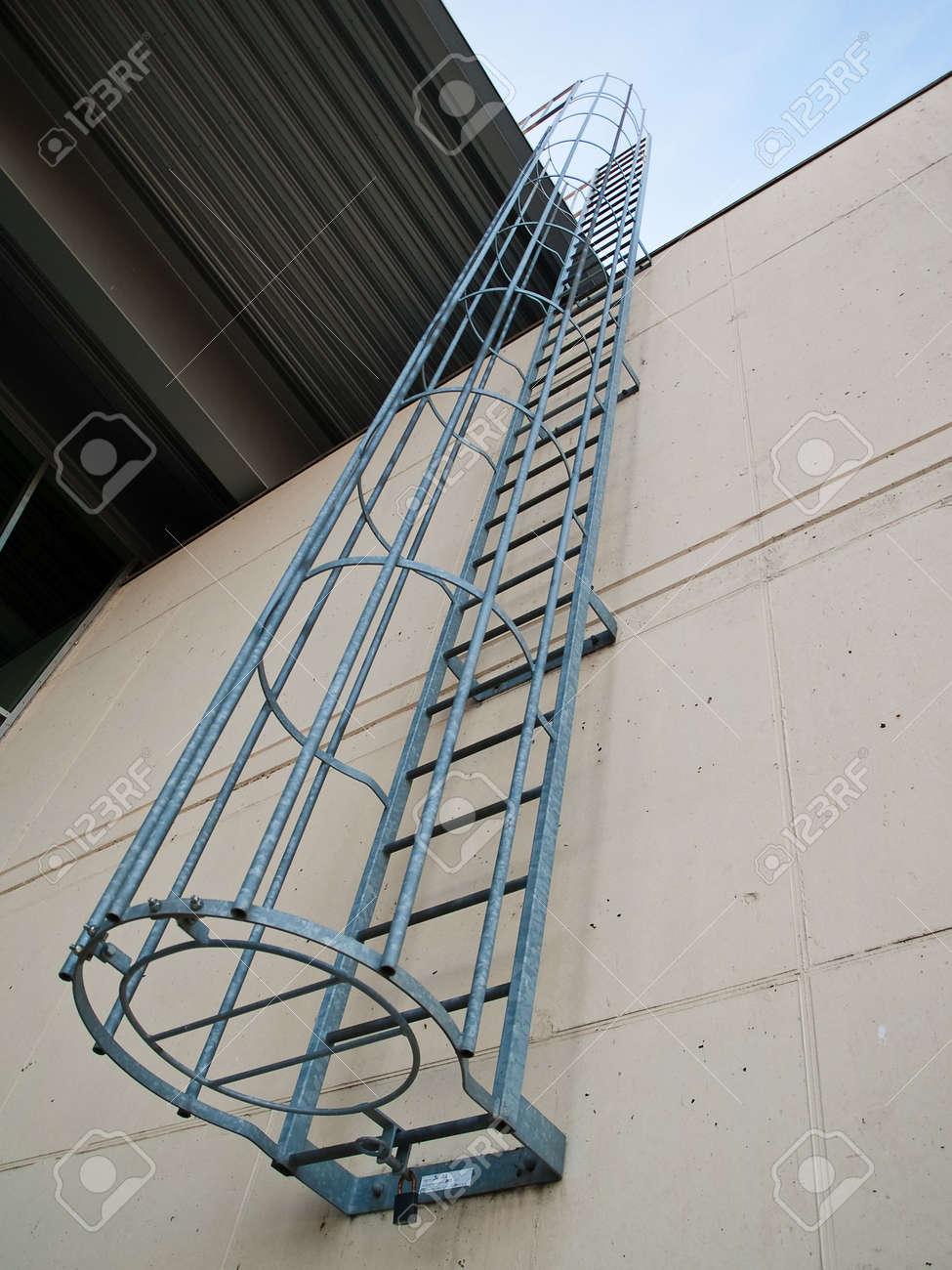 Apartment Building Fire Escape Ladder fire emergency escape ladder on a building vertical angle stock