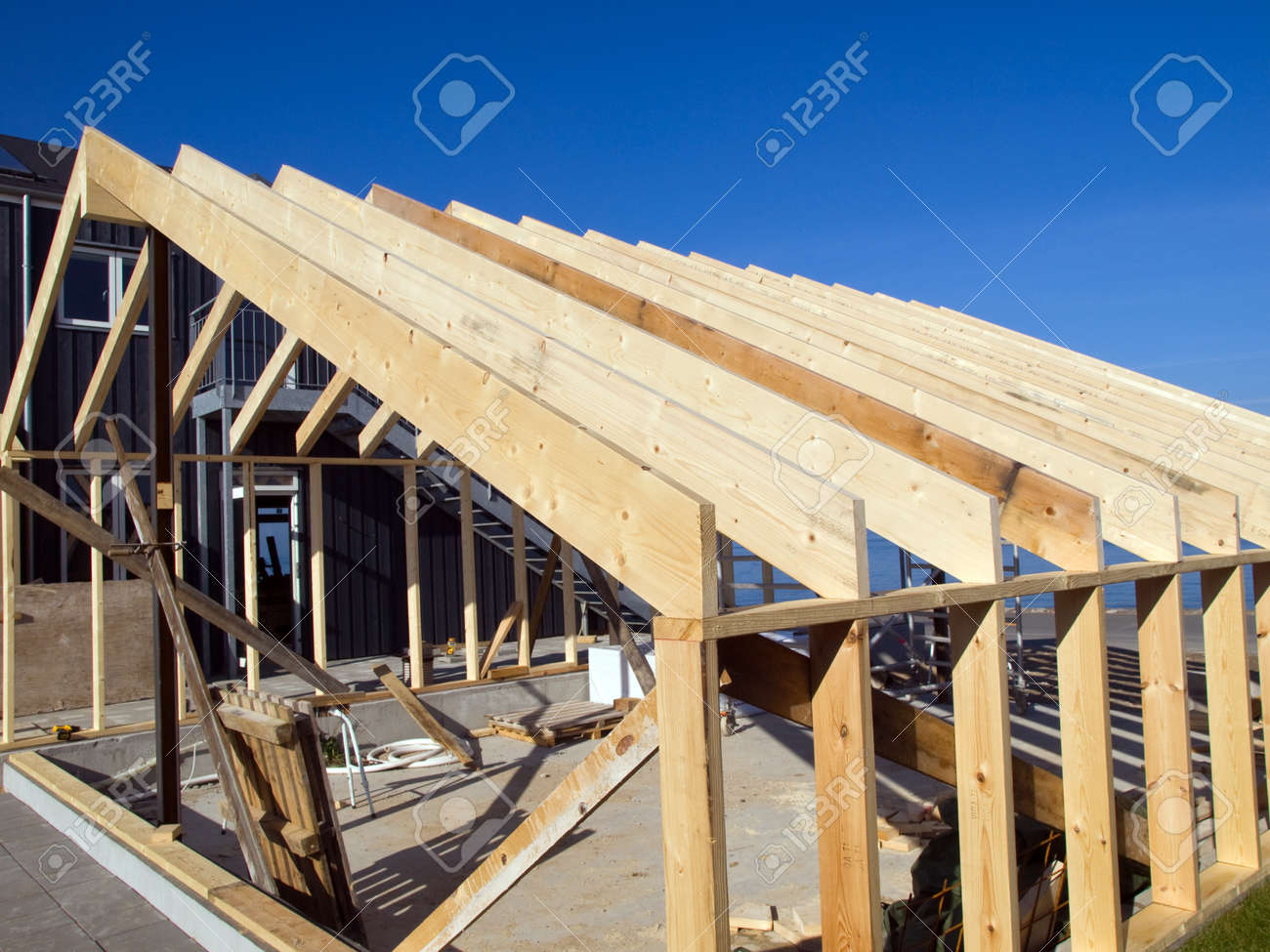 details of a wooden house building frame under construction stock